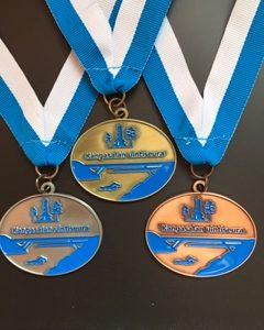 Kangasalan Uintiseura mitali omalla logolla.